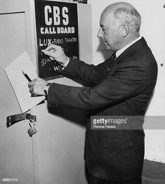 American director Cecil B DeMille chalks up the rehearsal time on the call board at CBS radio studios Hollywood California 1943 DeMille is the...