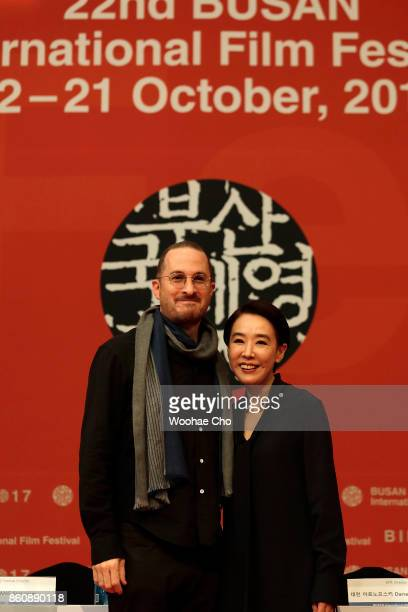 American director Darren Aronofsky and Kang Sooyoun the festival's executive director pause to the cameras at the official press conference for...