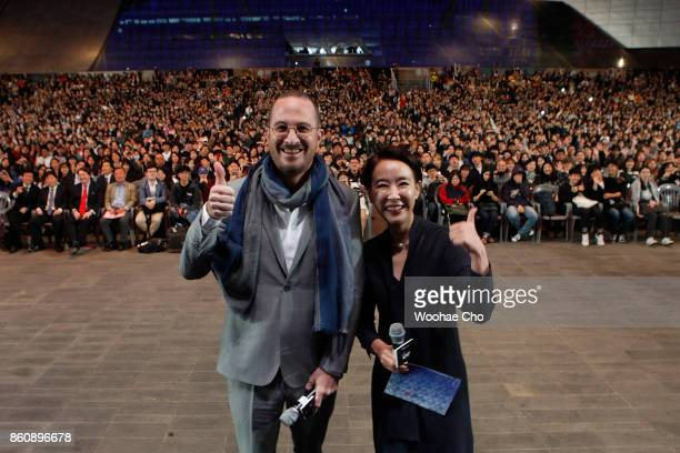 American director Darren Aronofsky and Kang Sooyoun the festival's executive director attend the official screening of 'mother' during the Busan...