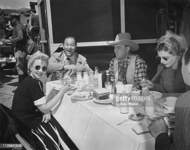 American director Edwin L Marin at lunch with members of the cast of his comedy film 'Maisie' during location filming in Chatsworth Los Angeles...