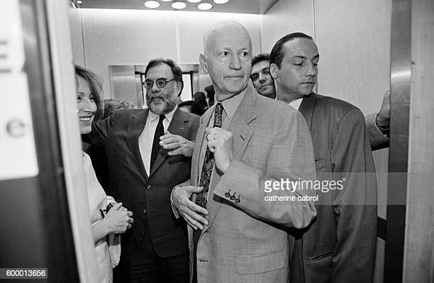 American director Francis Ford Coppola president of the jury for the 1996 Cannes Film Festival and Gilles Jacob crowd into an elevator