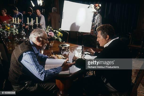 American director Gene Saks discusses a scene with Italian actor Marcello Mastroianni on the set of the 1991 film Cin cin in Biarritz. The Italian...