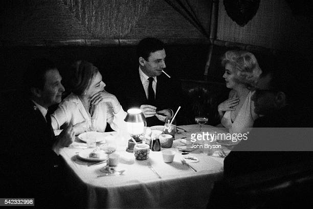 American director George Cukor French actress Simone Signoret Italianborn French actor and singer Yves Montand American actress singer and model...