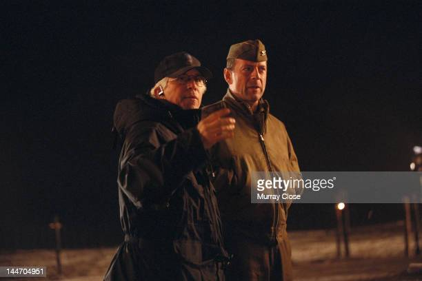 American director Gregory Hoblit with actor Bruce Willis on the set of their film 'Hart's War', 2002.