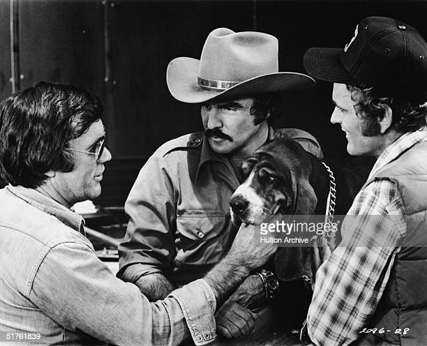 American director Hal Needham lines up a shot with actors Burt Reynolds and Jerry Reed and Happy on the set of the movie 'Smokey and the Bandit,'...