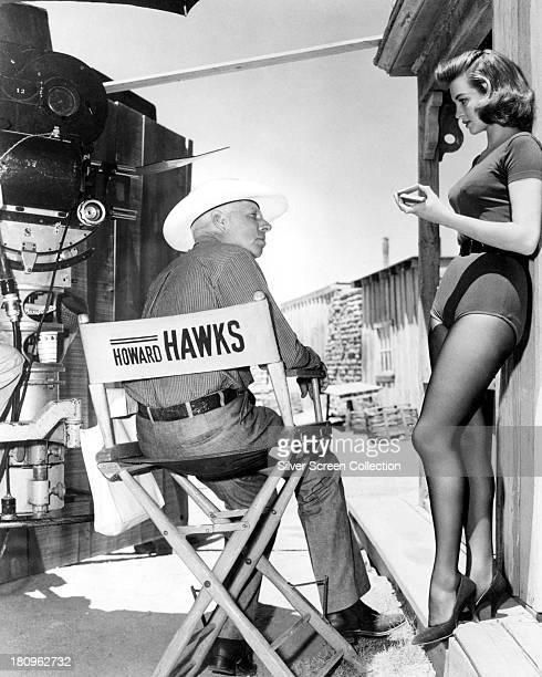 American director Howard Hawks with actress Angie Dickinson on the set of 'Rio Bravo' 1959