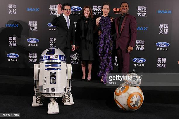 American director JJ Abrams American actress and scriptwriter Carrie Fisher British actress Daisy Ridley and British actor John Boyega attend...