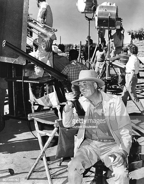 American director John Huston on the set of his movie The Unforgiven