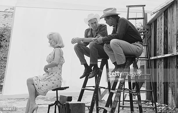 American director John Huston with actors Marilyn Monroe and Clark Gable in Nevada for the location filming of 'The Misfits'
