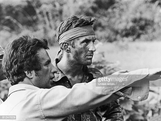 1978 American director Michael Cimino confers with American actor Robert De Niro on the set of Cimino's film 'The Deer Hunter'