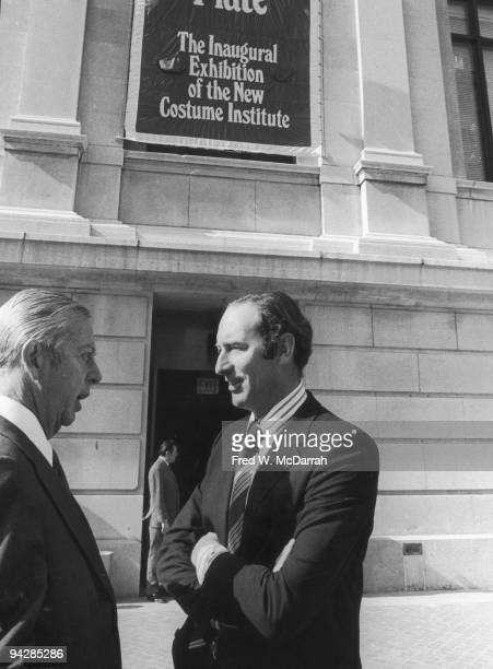 American director of the Metropolitan Museum of Art Thomas Hoving chats with an unidentified man at the inaugural exhibition of the Costume Institute...