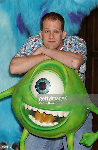 American director Pete Docter attends a promotional event for his new movie Monsters Inc February 1 2002 in Madrid Spain Docter stands behind the...