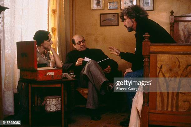 American director Philip Kaufman directing Portugese actress Maria de Medeiros and American actor Fred Ward on the set of his film 'Henry June' based...