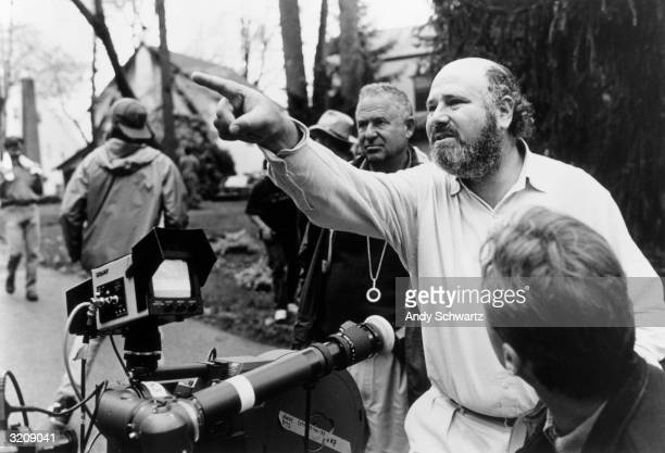American director producer and actor Rob Reiner gestures near a camera while crew members surround him outdoors on the set of his film 'North'