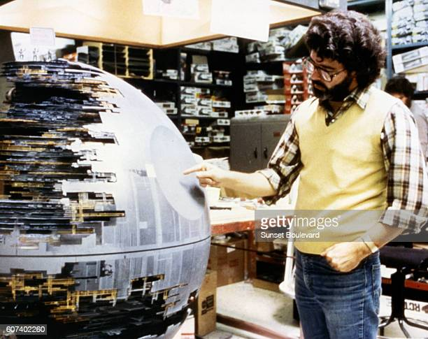 American director screenwriter and producer George Lucas looks at the Death Star from Return of the Jedi