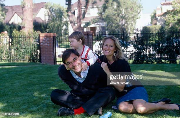 American director screenwriter and producer Oliver Stone his wife Elizabeth Burkit Cox and their son Sean in their Los Angeles home