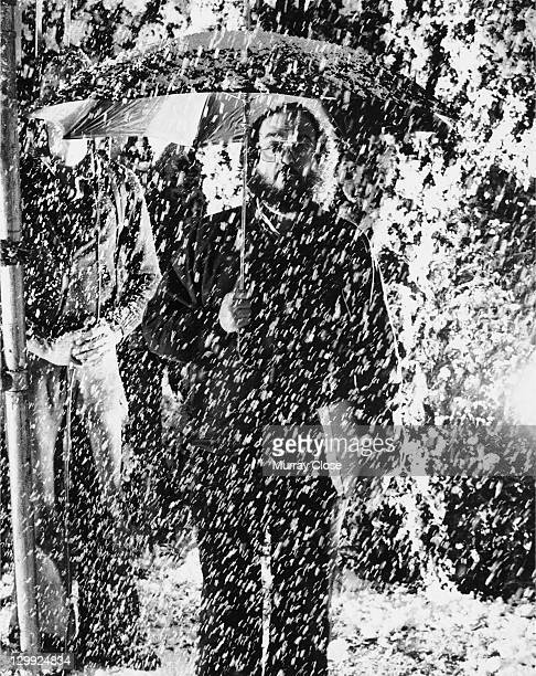 American director Stanley Kubrick withstands a blizzard of fake snow on the set of 'The Shining' 1980