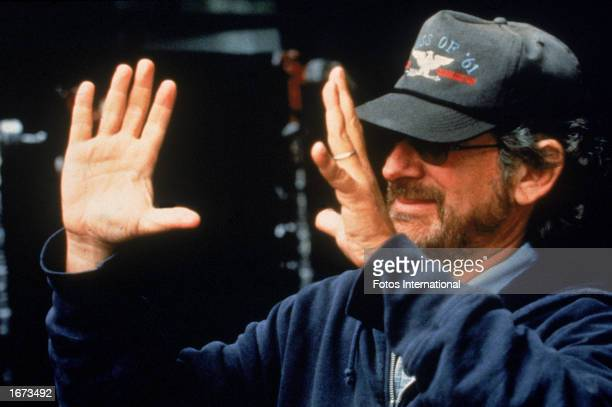 American director Steven Spielberg frames a shot on the set while directing his film 'Jurassic Park The Lost World' 1997