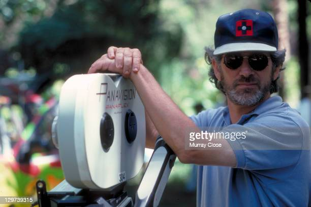 American director Steven Spielberg poses with a Panaflex camera on the set of the film 'Jurassic Park' 1993