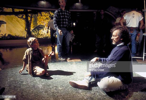 American director Steven Spielberg with child actor Joseph Mazzello during the filming of 'Jurassic Park' 1993