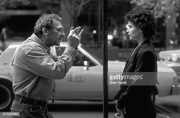 American director Sydney Pollack and British actress Julia Ormond discuss a scene while on location for their film 'Sabrina' New York 1995