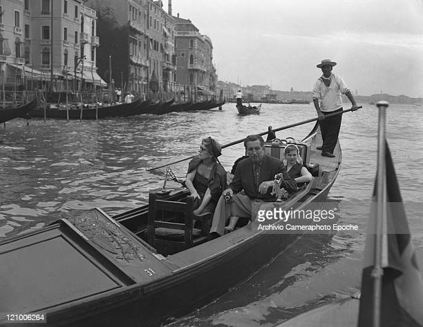 American director Walt Disney holding a camera portrayed sitting on a gondola with the family his wife Lillian and his daughters Diane Marie and...