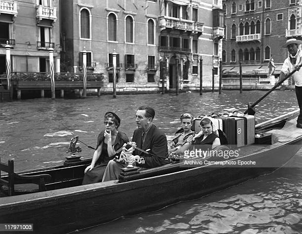 American director Walt Disney portrayed sitting on a gondola with the family his wife Lillian and his daughters Diane Marie and Sharon Mae along the...