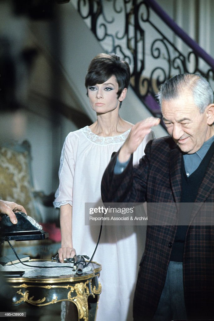 William Wyler and Audrey Hepburn in How to Steal a Million : News Photo