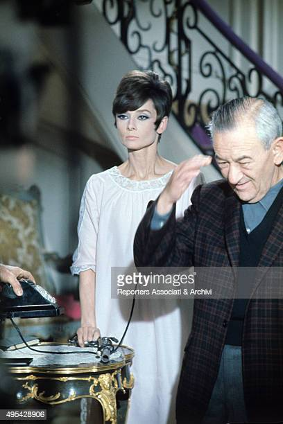 American director William Wyler directing British actress Audrey Hepburn on the set of the film How to Steal a Million 1966
