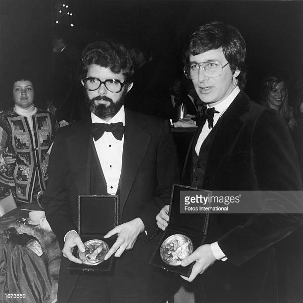 American directors George Lucas and Steven Spielberg hold their Best Director nomination plaques at the Directors Guild of America annual awards...