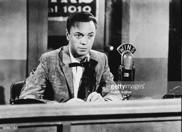 American disc jockey and radio performer Alan Freed who coined the term rock 'n' roll sits in a 1010 WINS sound studio during a radio broadcast 1950s