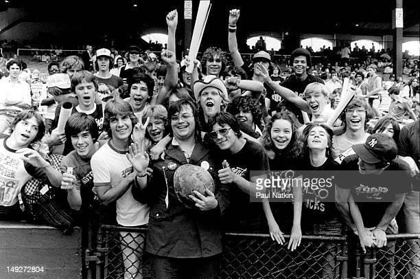 American disc jockey Steve Dahl poses with members of the crowd during an antidisco promotion at Comiskey Park Chicago Illinois July 12 1979 The...