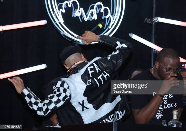 American DJ and art collector Swizz Beatz shows the artwork on his leather jacket at the Bacardi No Commission Marquee Performance hosted by The Dean...