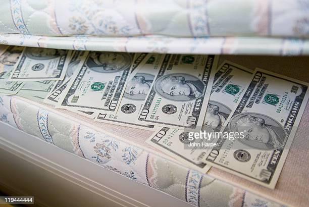 American dollars under mattress.