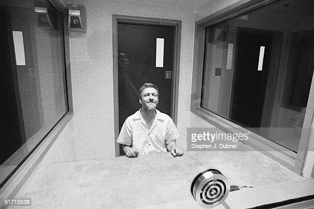 **EXCLUSIVE** American domestic terrorist luddite and mathematics teacher Ted Kaczynski smiles as he poses during an interview in a visiting room at...