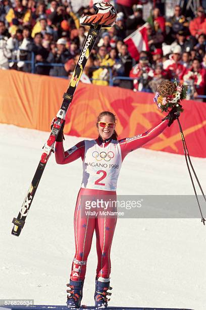 American downhill skier Picabo Street raises her skis and a bouquet in a symbol of victory after winning the gold medal in the SuperG giant slalom...