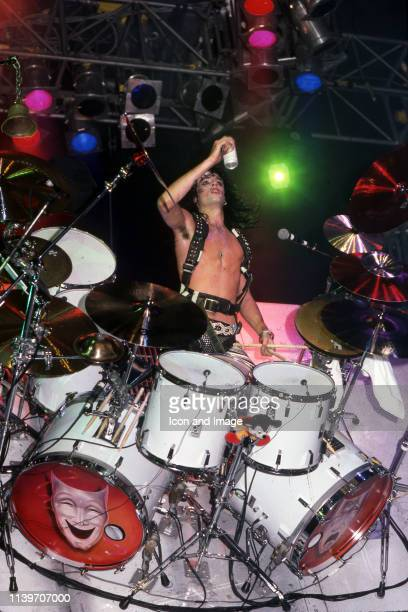 American drummer and cofounder of the heavy metal band Mötley Crüe Tommy Lee performs onstage at the Joe Louis Arena during the Theater of Pain tour...