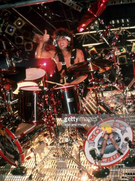 American drummer and founding member of the hard rock band Mötley Crüe Tommy Lee performs at the Joe Louis Arena during the Girls Girls Girls Tour on...