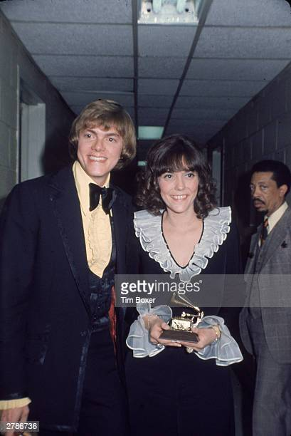 American easy listening duo Richard and Karen Carpenter stand backstage at the Grammy Awards holding their award circa 1970
