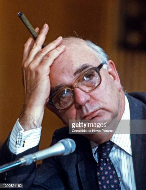 American economist Chairman of the Federal Reserve Paul Volcker holds a cigar as he testifies the US Senate Committee on Banking Housing and Urban...