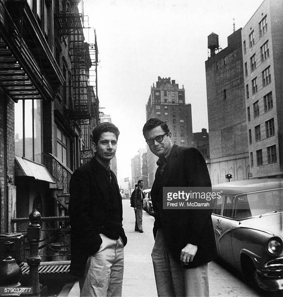 American editor Bill Ward and critic Seymour Krim pose together on a sidewalk New York New York March 16 1959
