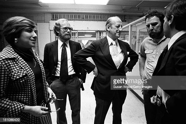 American editor of Newsweek magazine and former New York City deputy mayor Osborn Elliott stands with unidentified others during a tour of the Rikers...