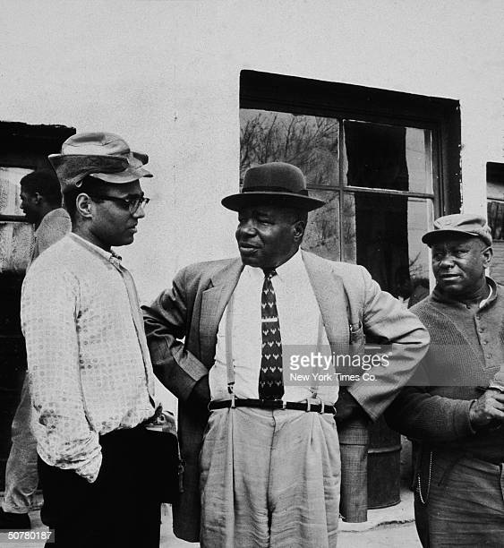 American educator and civil rights activist Robert P Moses speaks to two men during a voter registration project in Greenwood Mississippi April 1963