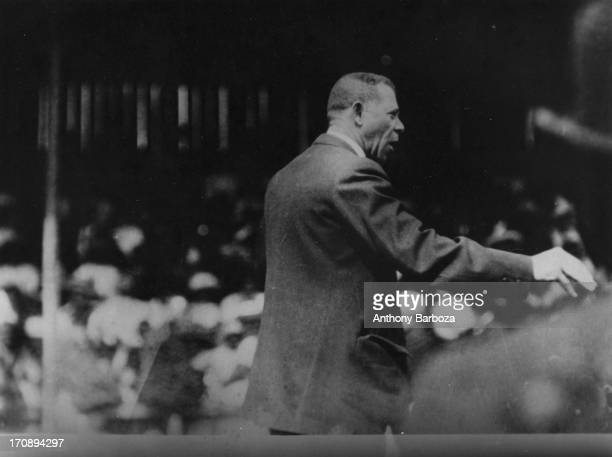 American author and orator Booker T Washington addresses a large crowd circa 1910
