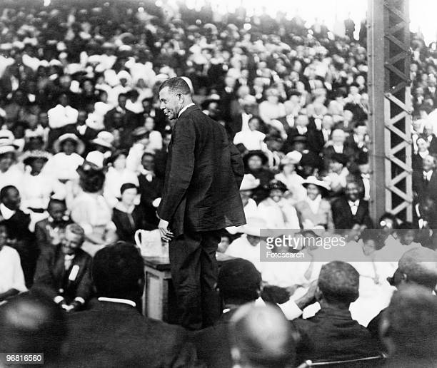 Booker T Washington addressing a large crowd circa 1910