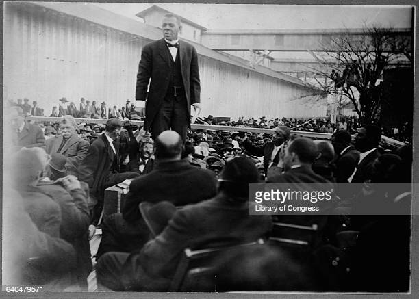 Educator and reformer Booker T Washington talks to a crowd at the dedication of a cotton seed mill in Mississippi