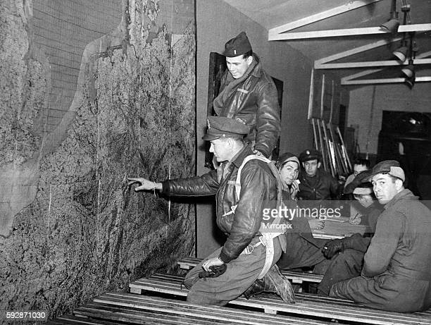 American Eighth Army Air Force crew members of the B17 Flying Fortress looking at a map of Germany as they arrive back at their base in England after...