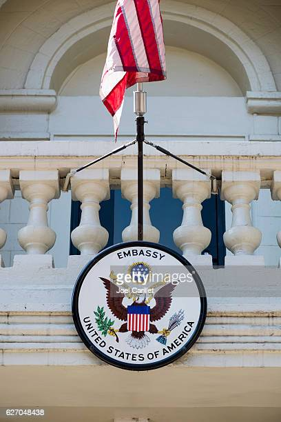 american embassy seal and u.s. flag in moldova - american flag eagle stock pictures, royalty-free photos & images
