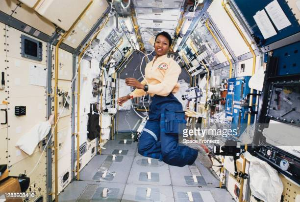 American engineer and astronaut Mae Jemison works in zero gravity in the centre aisle of the Spacelab Japan science module aboard OV-105, the Space...