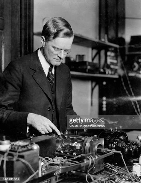 American engineer and inventor Richard H Ranger points to the electric lamp of his photoradiogram transmitter New York New York May 1924 The device...
